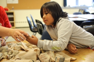 First Nations student examining mineral samples- photo courtesy of Noront Resources