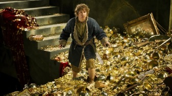 Bilbo ankle deep in gold in the castle chambers